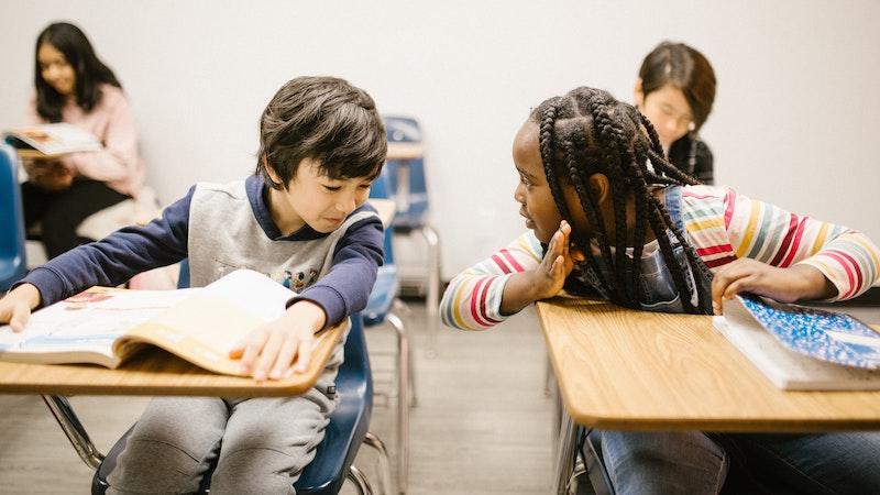 Girl and boy at adjacent desks